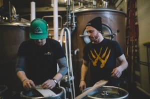 Dave Newsted and Marty Hueter brewing P.U.B. Lager at Wolverine State Brewing CO.
