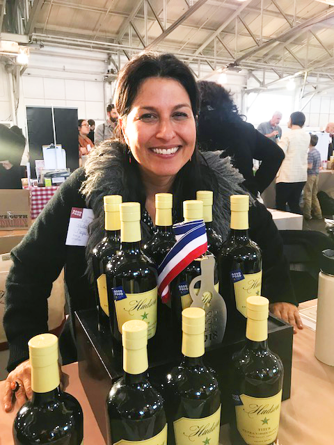 Cristina Hudson at the Good Food Awards with her award-winning olive oil.