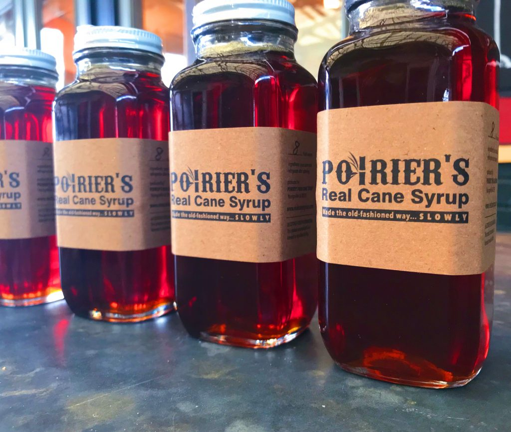 Bottles of Poirier's Real Cane Syrup.