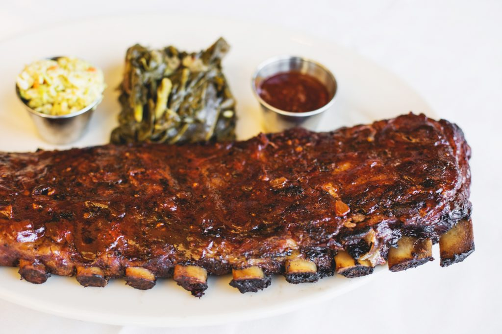A rack of Roadhouse ribs with Red Rage BBQ sauce.