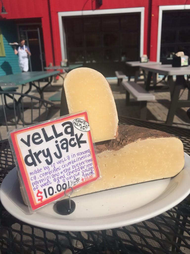 Cut open wheel of Ig Vella Dry Jack cheese.