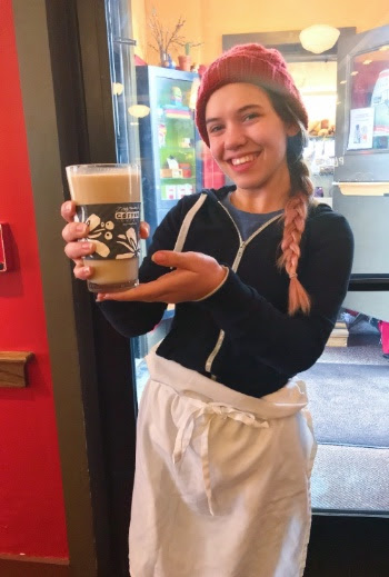 Roadshow server holding a glass of Rhode Island Coffee Milk