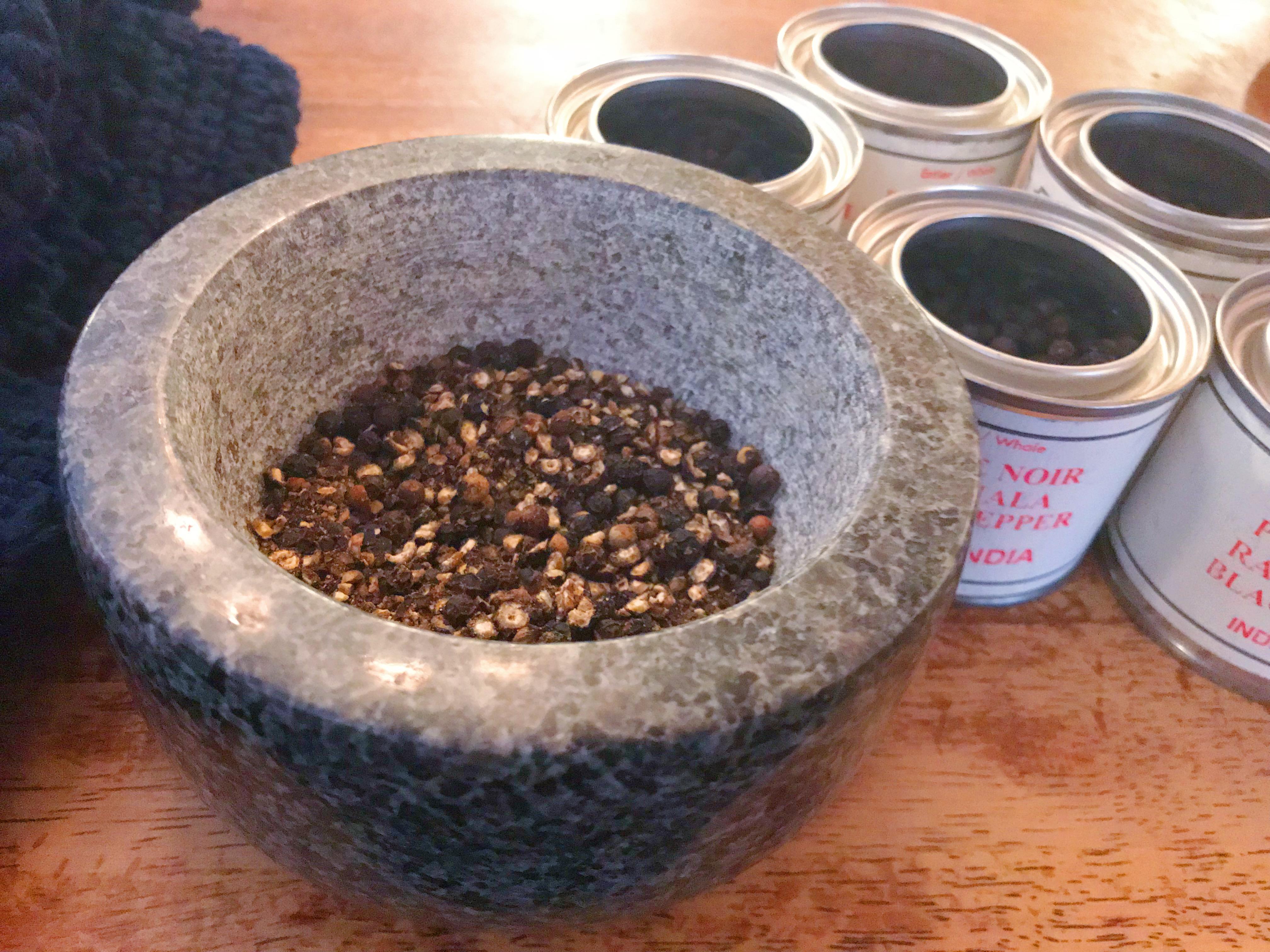 A mortar of freshly ground black pepper.