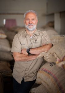Shawn Askinosie with bags of cocoa beans.