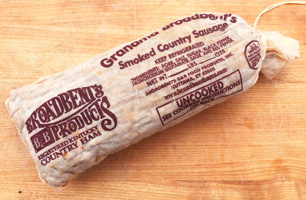 Broadbent Smoked Sausage wrapped in a muslin bag printed with the logo and nutrition information.