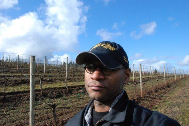 André Hueston Mack standing in his vineyard in Oregon.