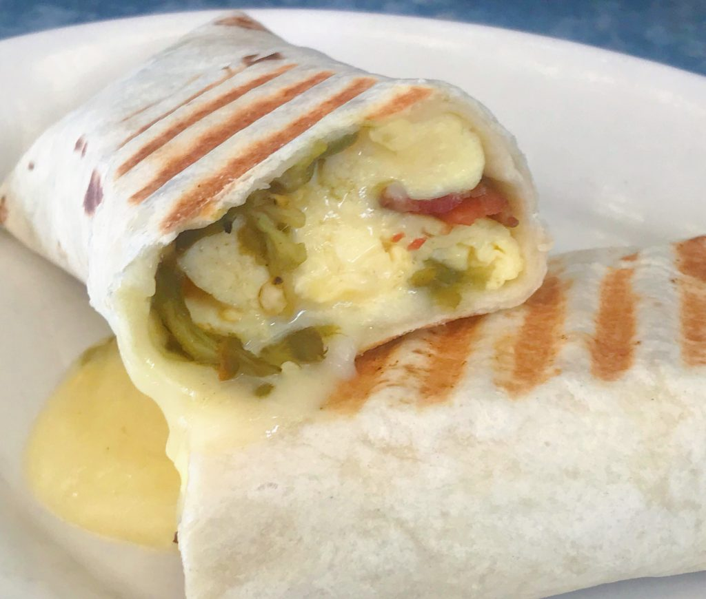 A Diez y Uno breakfast burrito from Zingerman's Roadshow, cut in half to show off the New Mexico green chilies.
