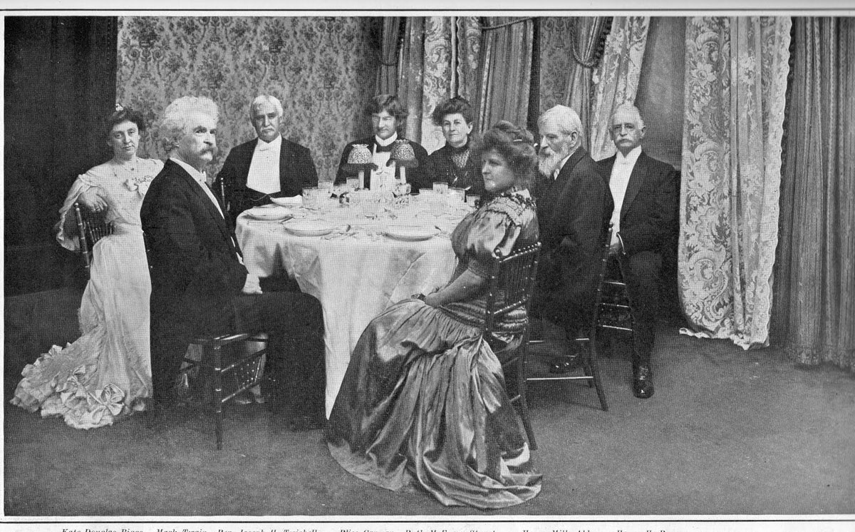 A black and white photograph of Mark Twain and fellow diners at Delmonico's Restaurant in New York, 1905.