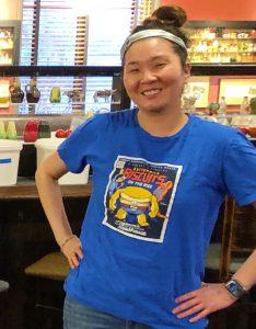 A Roadhouse staff member wearing a Zingerman's Roadhouse t-shirt.