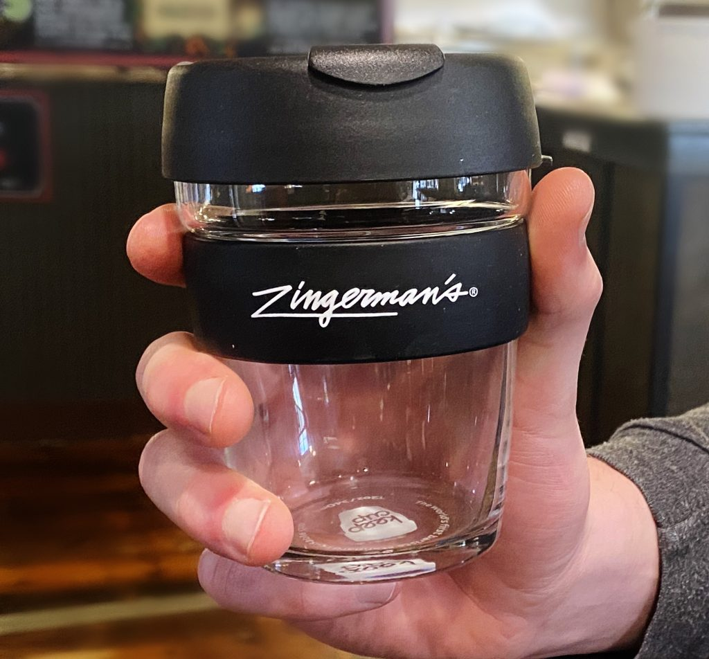 A Zingerman's Keep Cup for to-go coffee.
