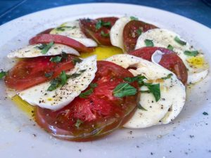 An insalata caprese made with heirloom tomatoes.
