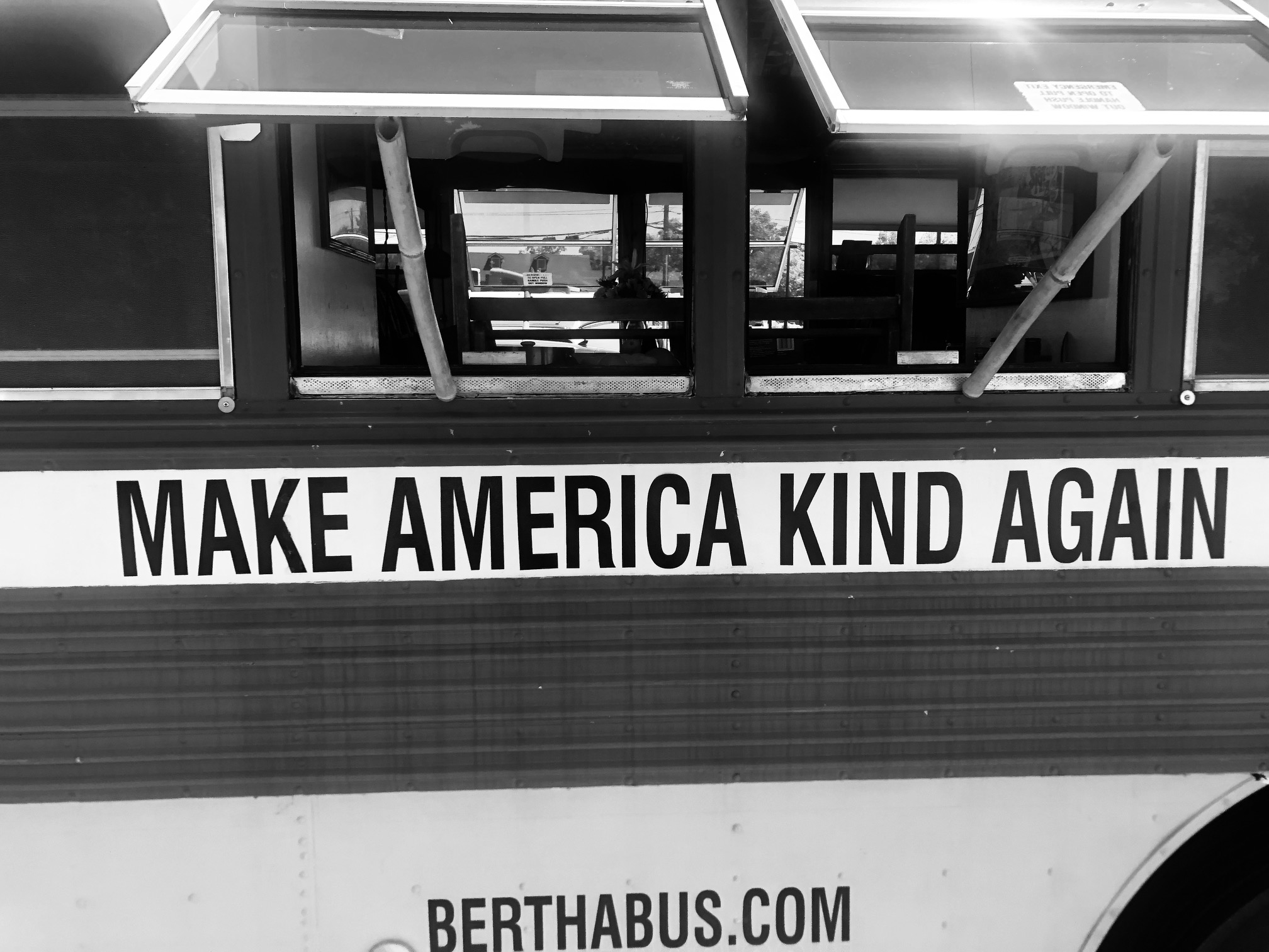 A bus with the words Make America Kind Again on the side.