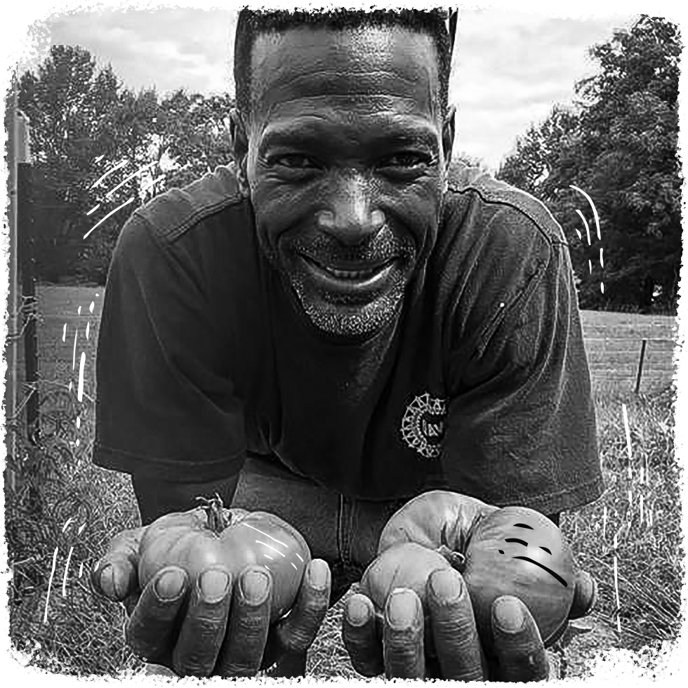 Local Farmer Melvin with two Heirloom Tomatoes