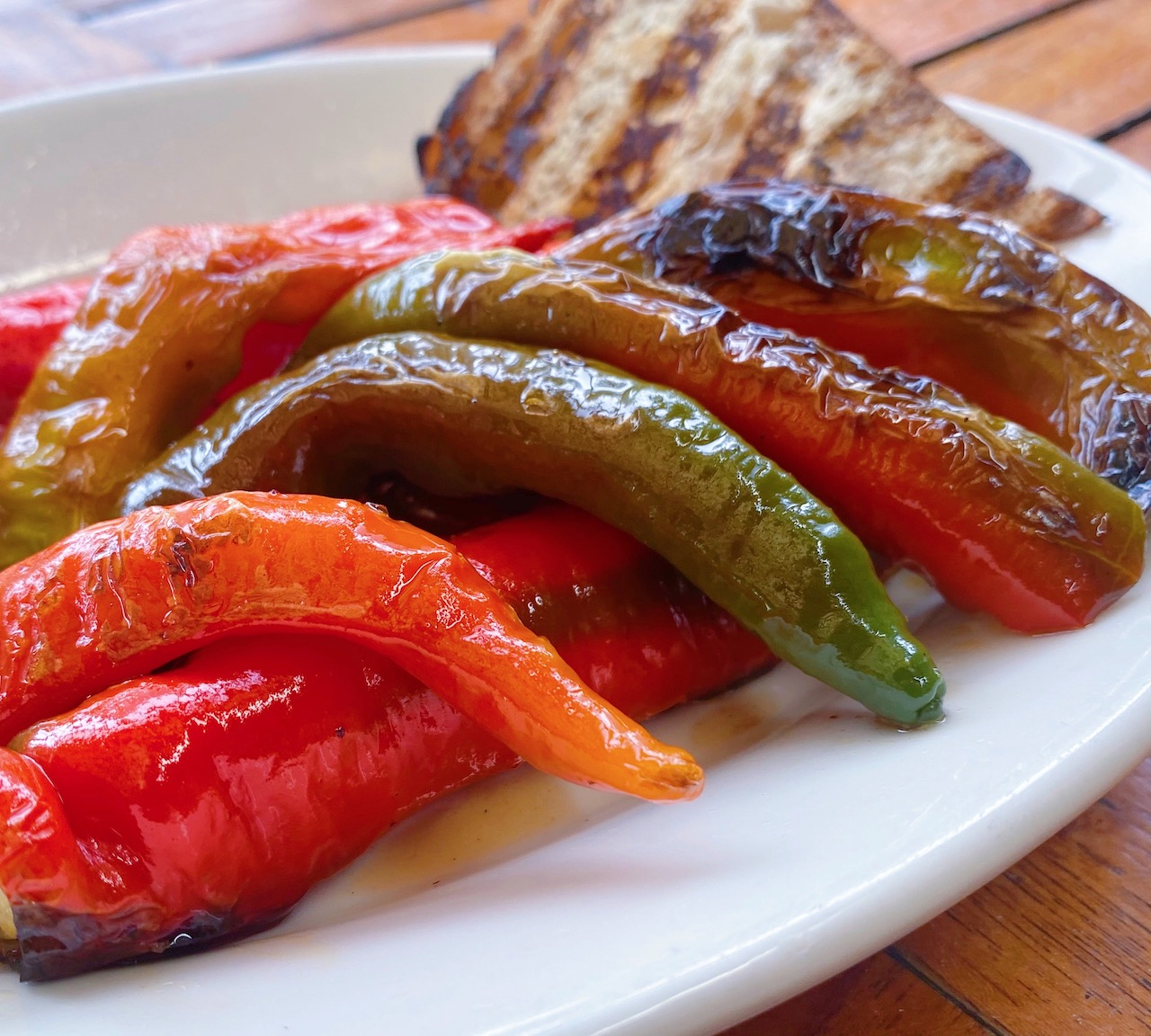 A plate of fried Jimmy Nardello peppers.