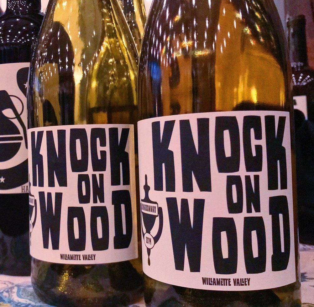 Bottles of Knock on Wood Chardonnay by winegrower Andre Hueston Mack